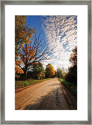 Framed Print featuring the photograph Dirt Road And Sky In Fall by Lars Lentz