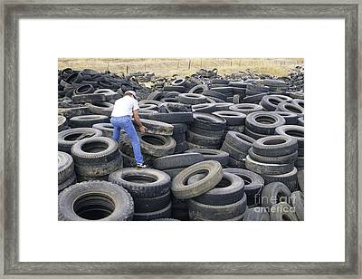 Discarded Old Tires Piled For Recycling Framed Print