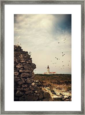 Distant Lighthouse Framed Print by Carlos Caetano