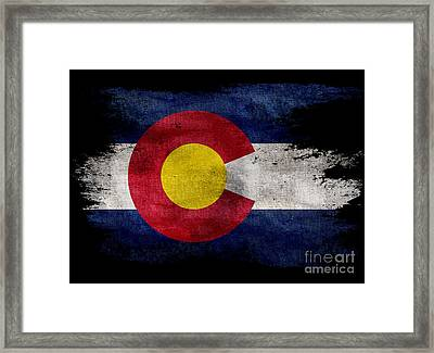 Distressed Colorado Flag On Black Framed Print by Jon Neidert