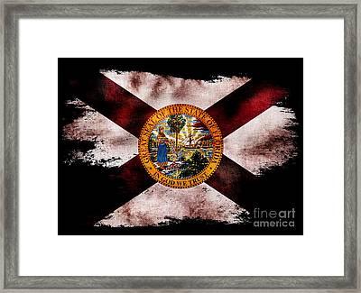 Distressed Florida Flag On Black Framed Print by Jon Neidert