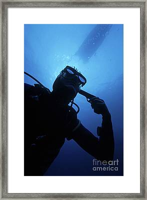 Diver Holding Gun To Head Underwater Framed Print by Sami Sarkis
