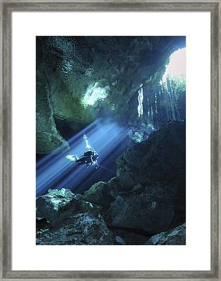 Diver Silhouetted In Sunrays Of Cenote Framed Print by Karen Doody