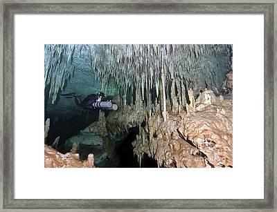 Diver Using Side Mount Gear In Cave Framed Print