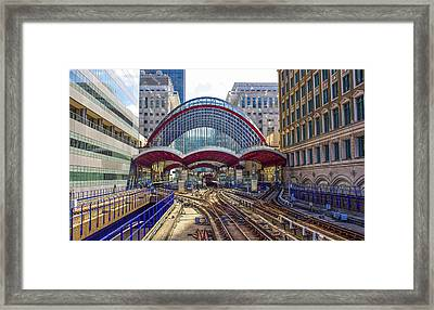 Dlr Canary Wharf And Approaching Train Framed Print by Venetia Featherstone-Witty
