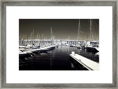 Dock In The Port Framed Print by John Rizzuto