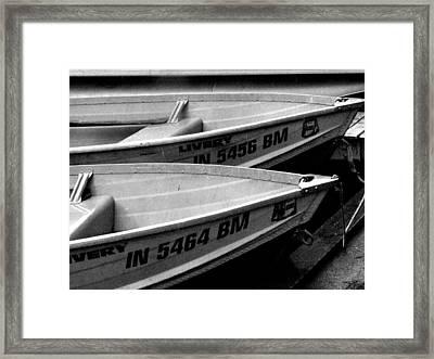 Docked Rowboats Framed Print by Michael L Kimble