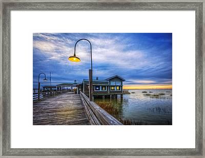 Docks At Nightfall Framed Print by Debra and Dave Vanderlaan