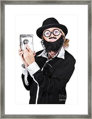 Doctor Examining Hard Drive Framed Print by Jorgo Photography - Wall Art Gallery
