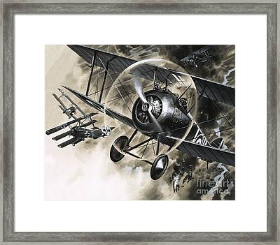 Dog Fight Between British Biplanes And A German Triplane Framed Print by Wilf Hardy