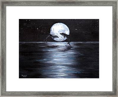 Dolphins Dancing Full Moon Framed Print by Bernadette Krupa