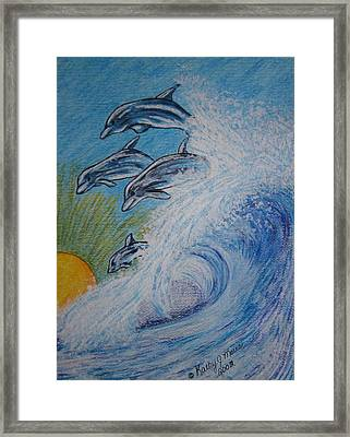 Dolphins Jumping In The Waves Framed Print by Kathy Marrs Chandler