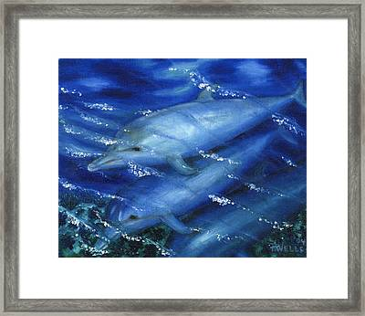 Dolphins Swimming Framed Print by Tanna Lee M Wells