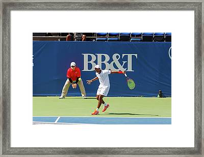 Donald Young Plays In The Winston-salem Open. Framed Print by Bryan Pollard