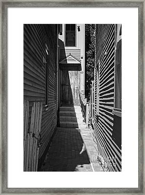 Door In An Alley Framed Print