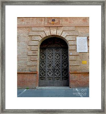 Door In Ferrara, Italy Framed Print
