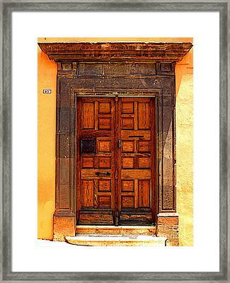 Door Of Wood And Stone Framed Print