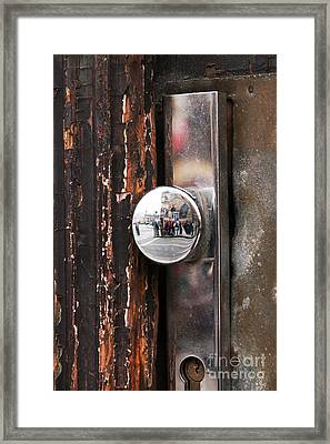 Door Reflections Framed Print by John Rizzuto