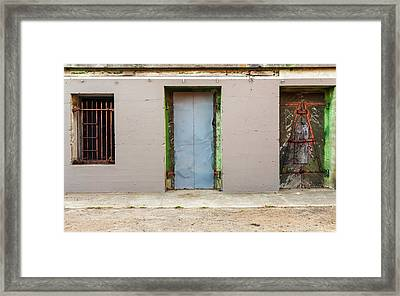 Doors And Bard Windows Framed Print by Javier Flores