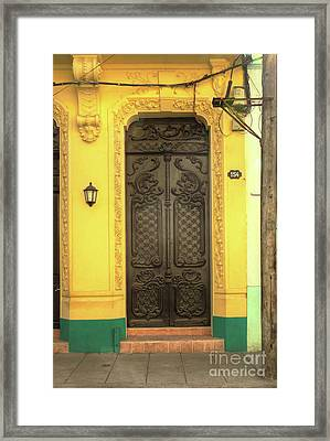 Doors Of Cuba Yellow Door Framed Print by Wayne Moran