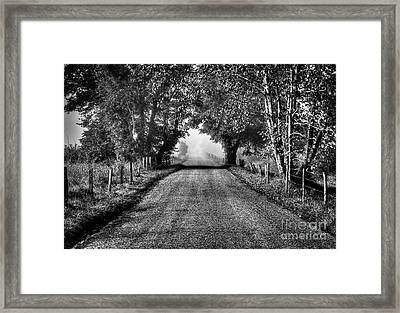 Down A Lonely Road Framed Print