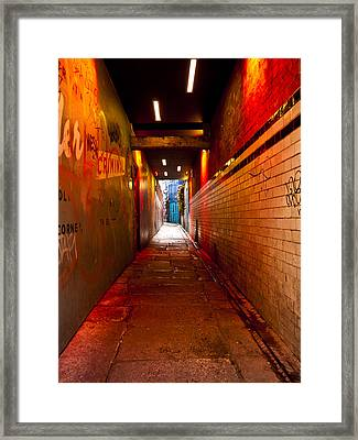 Down The Red Tunnel Framed Print by Rae Tucker