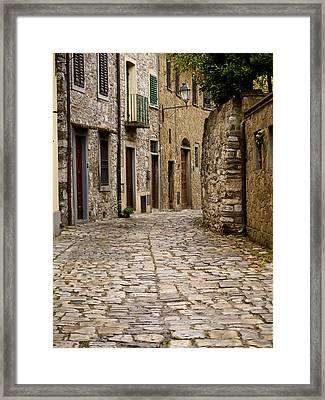 Down The Road In Montefiorella Framed Print by Rae Tucker