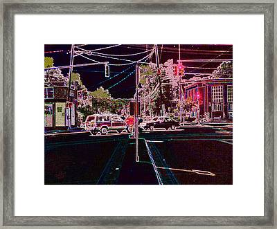 Downtown Eclipse Framed Print by Cliff Wilson