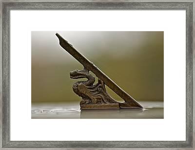 Dragon Figure On Sundial Framed Print by Robert Joseph