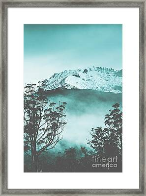 Dramatic Dark Blue Mountain With Snow And Fog Framed Print