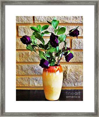 Dried Roses Against Stonewall Framed Print
