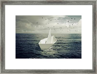 Drifting Paper Boat Framed Print by Carlos Caetano