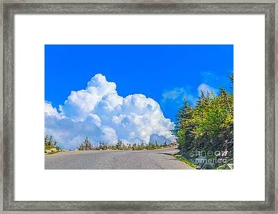 Driving Into The Clouds Framed Print