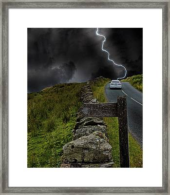 Driving Into The Storm Framed Print