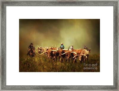 Driving The Herd Framed Print by Priscilla Burgers