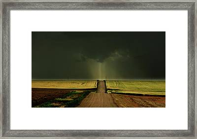 Driving Toward The Daylight Framed Print
