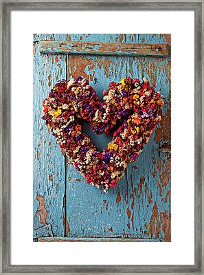 Dry Flower Wreath On Blue Door Framed Print by Garry Gay