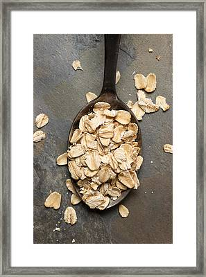 Dry Oatmeal Flakes In Spoon Framed Print by Donald  Erickson