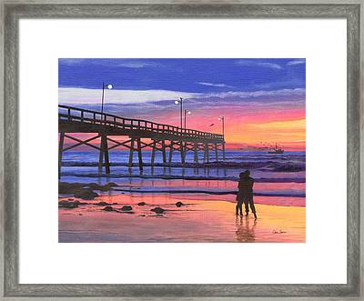 Dusk At The Pier Framed Print by Christopher Spicer