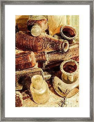 Dust Covered Medicine Bottles Framed Print