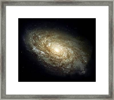 Dusty Spiral Galaxy  Framed Print by Hubble Space Telescope