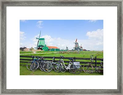 dutch windmills with bikes in Zaanse Schans Framed Print