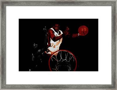 Dwyane Wade Rises Over Dirk Framed Print by Brian Reaves