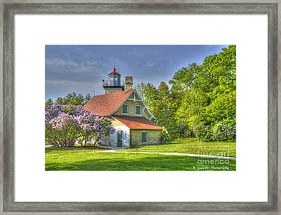 Eagle Bluff Lighthouse Framed Print by Mike Griffiths