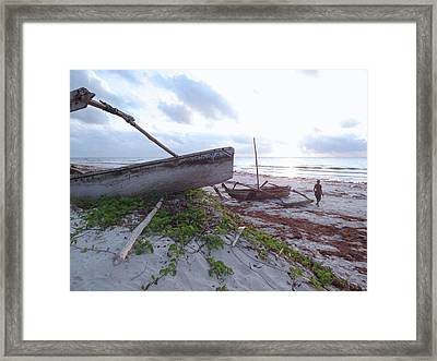 early morning African fisherman and wooden dhows Framed Print