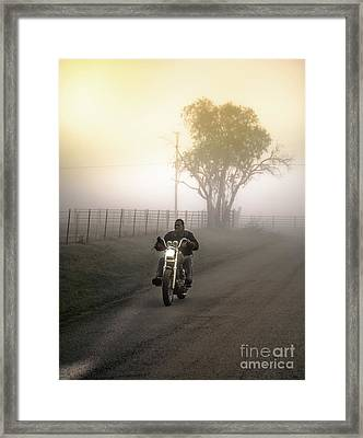 Early Rider In Fog Framed Print by Robert Frederick