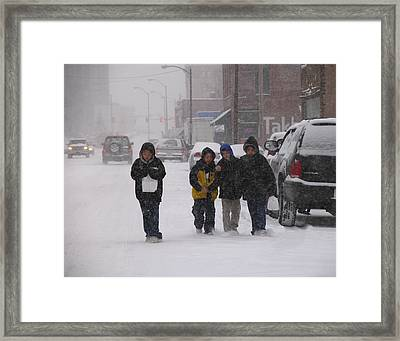 Eating Doughnuts In The Snowstorm Framed Print by Don Wolf