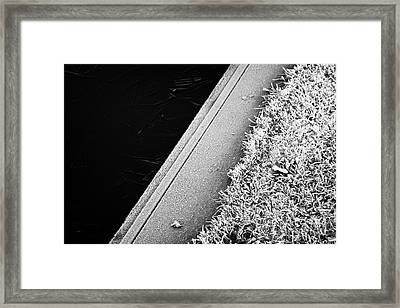 Edge Of Frozen Small Lake Pond On A Cold Winter Morning In The Uk Framed Print by Joe Fox