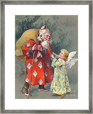 Edwardian Christmas Card Of Father Christmas Carrying A Sack And Talking To An Angel Framed Print