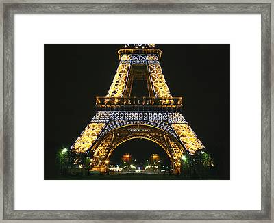 Eiffel Tower At Night Framed Print by Hans Jankowski